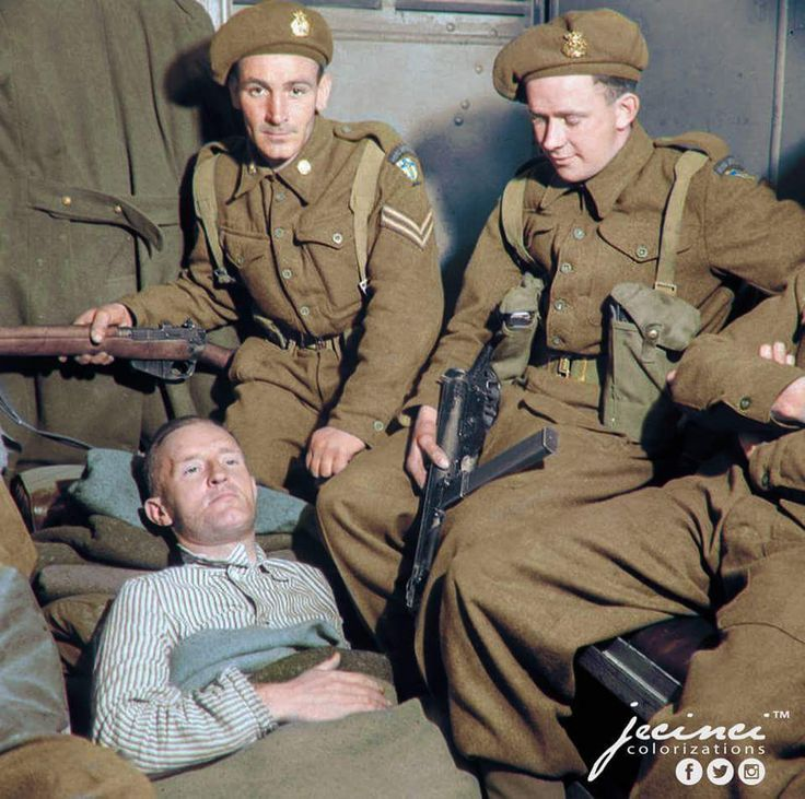 """The Capture of William Joyce, known as """"Lord Haw Haw"""", the Fascist politician and Nazi propaganda broadcaster in Germany, May 1945. He lies in an ambulance under armed guard before being taken from..."""