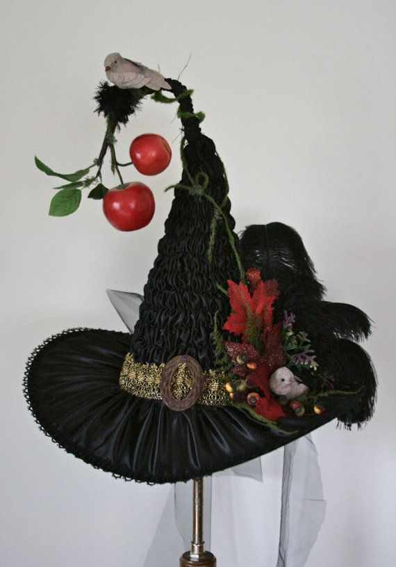 The poison apple, wicked witch, hand sculpted, ruched, Victorian witch hat. The material used for this hat is a shiny black satin material. Beautiful