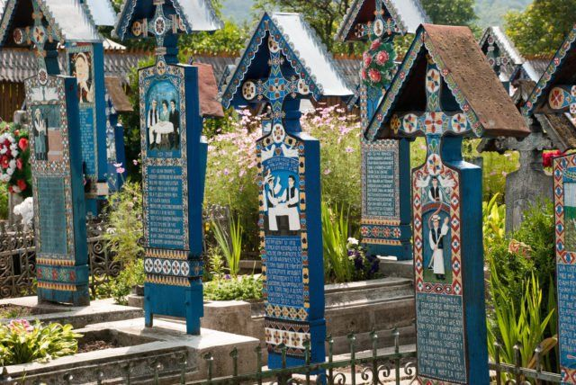 The Merry Cemetery crosses in pale blue color. Source