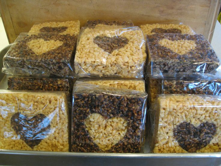 """Make one giant pan of regular rice crispies, another of rice crispies with oreo cookie crumbs and melted chocolate chips added. Cut in 4"""" squares. Using a sturdy heart cookie cutter, cut out centers and switch back and forth. These are wrapped in celophane for a Valentine's Day bake sale!"""