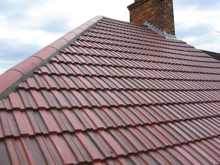 Residential property featuring Redland 49 Roof Tiles. Rustic Red colour.