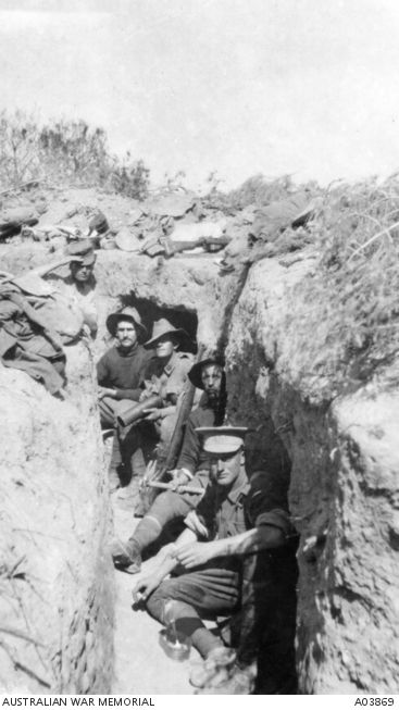 Men of the 8th Battalion in an abandoned Turkish position on Bolton's Ridge. Identified from back to front: 556 Private (Pte) Ted 'Kid' Freeman of Dooen, Vic (originally of Hobart, Tas), later honorary Captain and MC, Company Quartermaster; 533 Pte George Clements of Dimboola, Vic; 527 Pte James B 'Jim' Bryant of Stawell, Vic, holding an enemy shellcase; 617 Pte Samuel 'Sam' Wilson of Dimboola, Vic (later KIA); and 571 Pte Robert Hutchinson of Horsham, Vic.   A03869 | Australian War Memorial