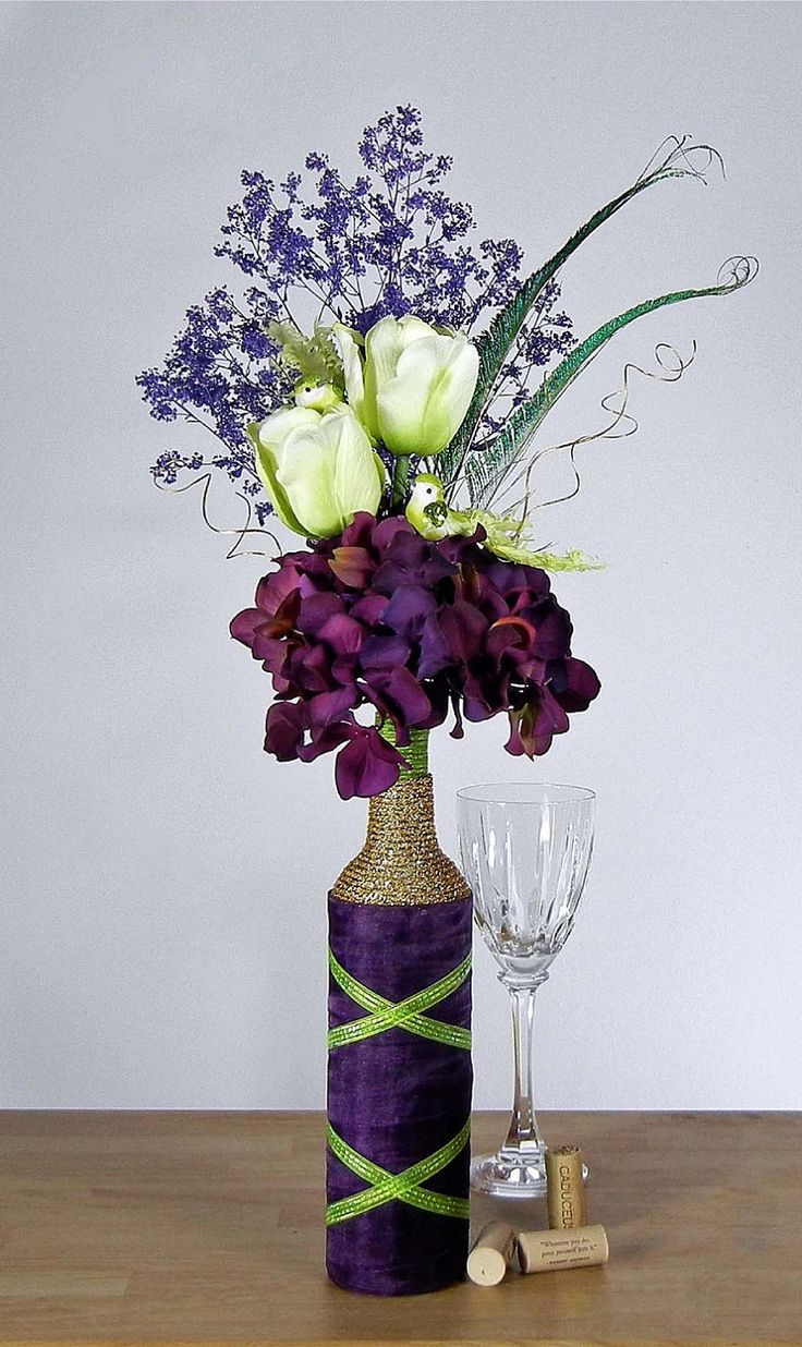 Eggplant Purple Floral Arrangement with Hydrangeas, Green Tulips, Peacock Feathers, Lovebirds and Upcycled Wine Bottle Vase. $35.00, via Etsy.