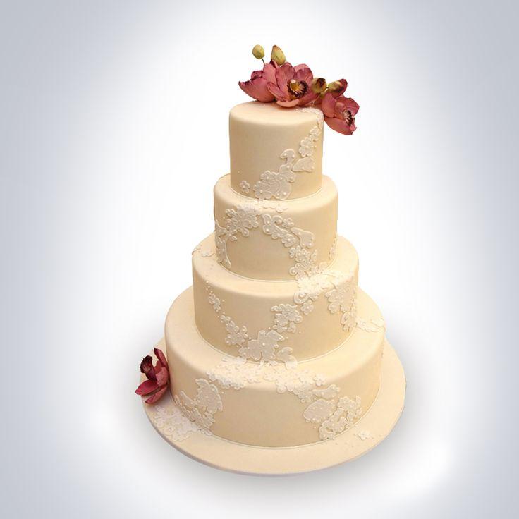 Daca esti in cautarea unui model de tort elegant, rafinat, care sa spuna povestea ta in cel mai potrivit mod, atunci tortul pentru nunta Ivory, decorat cu orhidee si dantela delicata, este alegerea perfecta. Culorile si sortimentul tortului sunt la alegerea ta. Pret: 600 de lei.