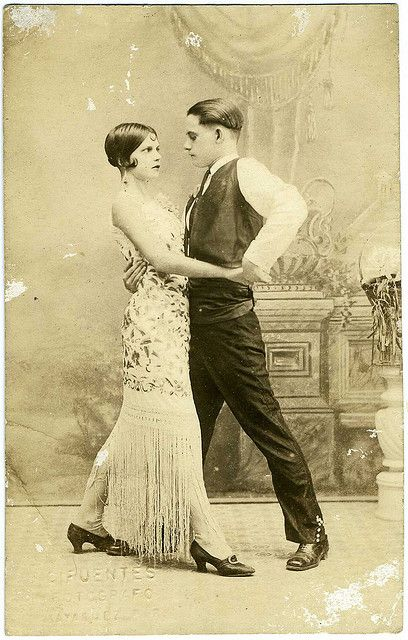 soyouthinkyoucansee:  Real Photo Postcard: Young Couple  [Lolita y Juan]  Their last name is on the verso, I always knew Lolita was hot; now i know she's smokin.   Love photos of women wearing large Canton shawls as gowns! Best known is of course the tango scene in The Four Horsemen of the Apocalypse, but it was a fairly popular look.