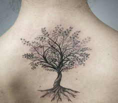 tree tattoo on woman's back