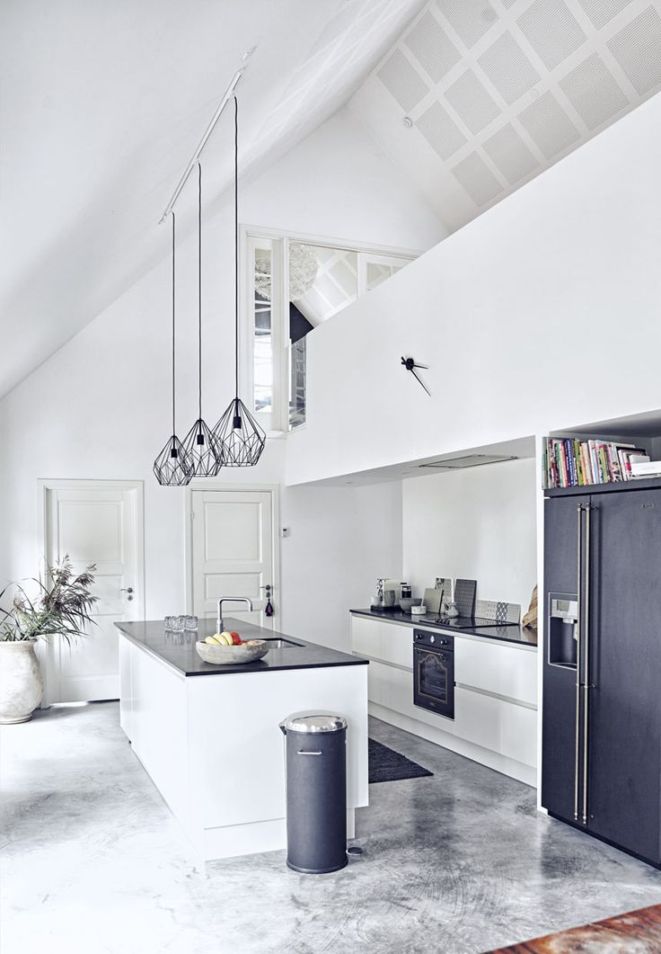 White kitchen with high ceiling