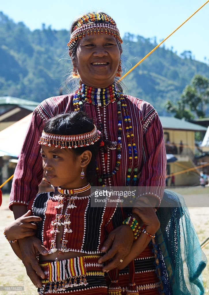 An ethnic Igorot mother with her daughter decked in their traditional attire wait for the start of the parade during the celebration of the Lang Ay Festival in Bontoc on April 6, 2013 in Mountain province, Philippines. The annual Lang Ay festival commemorates the anniversary of the foundation of the Mountain Province with street dances, theatrical performances, sporting events, and agricultural trade fairs that showcase the rich local history and culture of different mountain tribes in the…