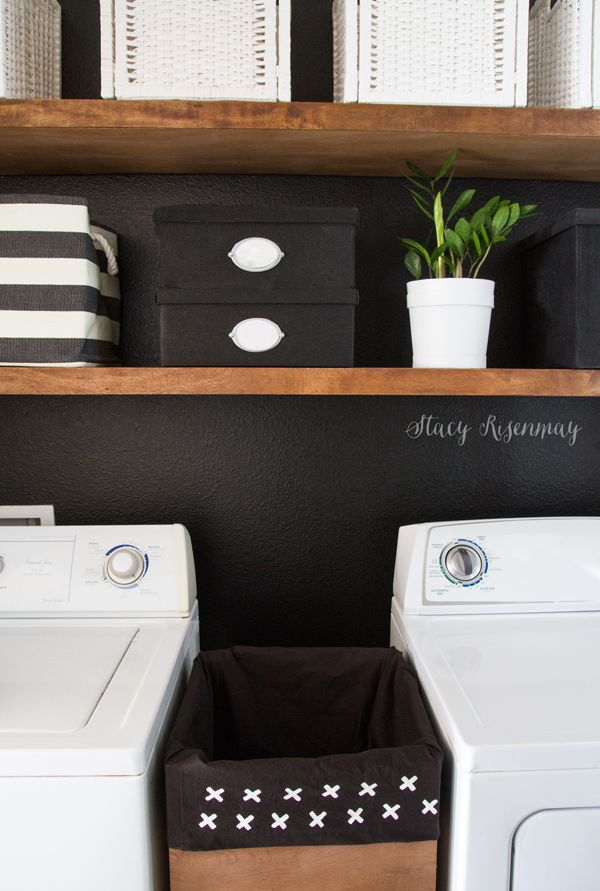 I love this black and white laundry room with plywood shelves and plywood hamper!