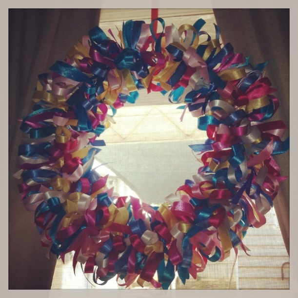 Using up old ribbon to make a wreath. Just to add about of colour to the room