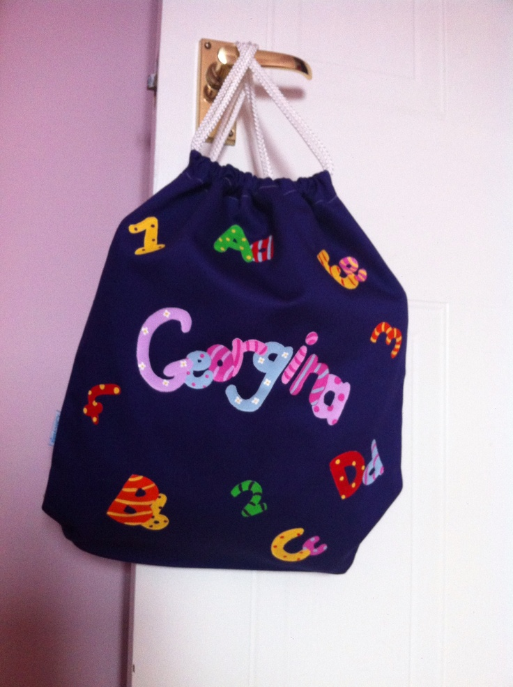 Little Georgina loves going to nursery with her personalised bag.