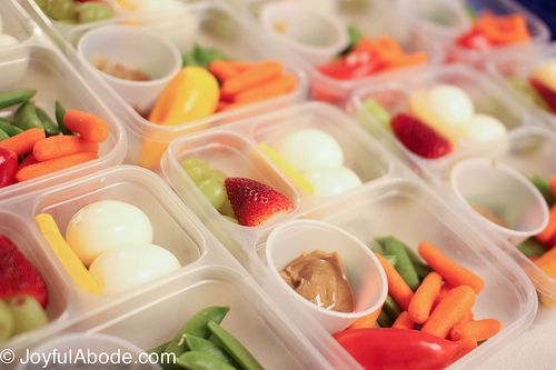 """DIY Starbucks-esque """"Bistro Boxes"""" // hard boiled eggs, grapes, strawberries, baby carrots, sugar snap peas, mini sweet peppers, almond butter, sharp cheddar #organize #prepday"""