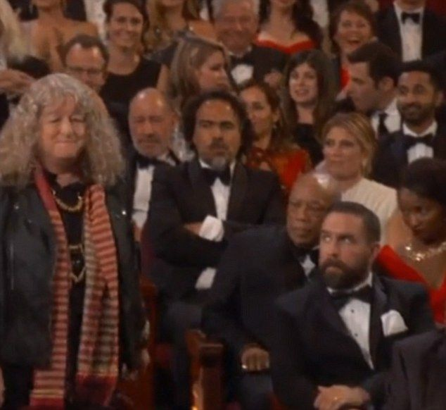 """British costume designer Jenny Beavan, 65, did not receive an applause from many in the Hollywood auditorium as she walked up to collect her Oscar award forBest Costume Design on Mad Max: Fury Road  and those truculent looking men are total """"shts"""""""