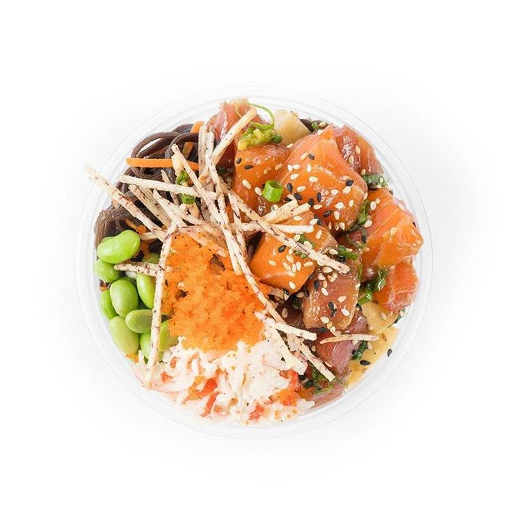 """The """"Soba"""" poké bowl. Base of soba noodles -- topped with cubes of sashimi-grade salmon and tuna, edamame, toasted black and white sesame seeds, shredded carrots, tobiko, finely diced green scallion, bonito flakes and crunchy taro sticks."""