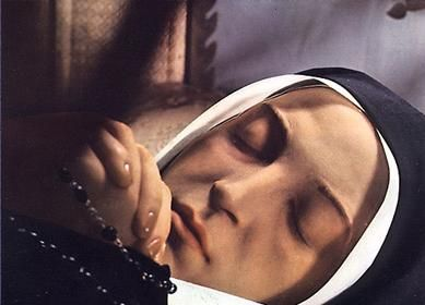 """The bodies of incorrupt saints do not undergo rigor mortis; rather, they remain as flexible as if the deceased were only sleeping. Incorrupt bodies are also miraculously free from the odor of decay, and many are reported to give forth the """"Odour of Sanctity,"""" an inexplicable sweet or flowery aroma. St Bernadette."""