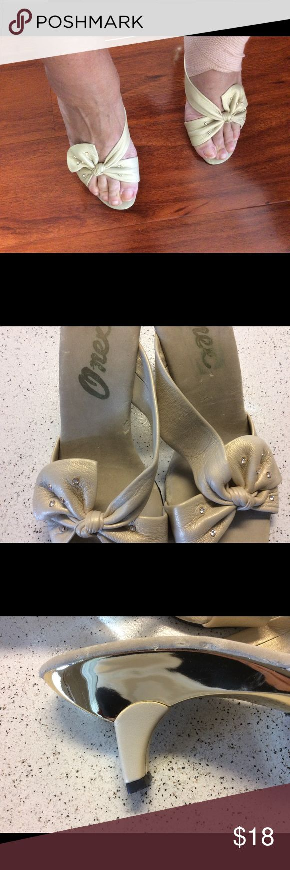 Onex pumps with rhinestones. The classic Onex shoe with leather and its signature design will wow anyone! Has rhinestone accents in the bow. These shoes were never worn but do show a slight discoloration on the inside of the shoe. onex Shoes Sandals