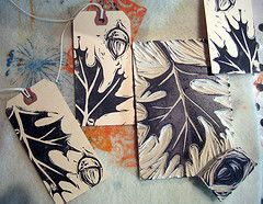 linocut oak leaves and acorns printed on tags by Janelafazio
