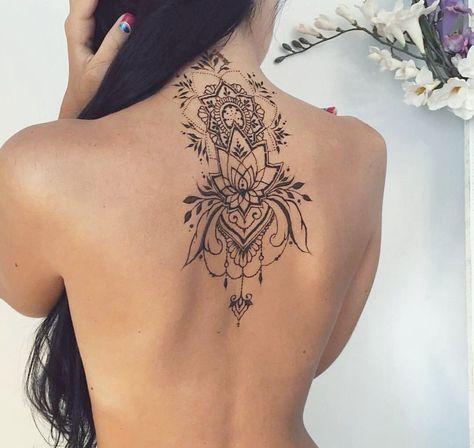 Back lotus tat