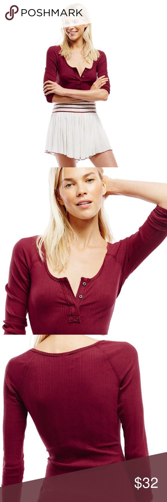 """Free People """"Jill"""" Henley Top Free People stretchy rib classic henley features hidden snap closures on the placket and a low scoop neckline. Three-quarter length sleeves and exposed trim detailing. 95% Cotton 5% Spandex Free People Tops"""