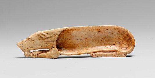 Cosmetic Spoon in Shape of Dog    Period:      New Kingdom  Dynasty:      Dynasty 18  Date:      ca. 1550–1295 B.C.  Geography:      Egypt  Medium:      bone