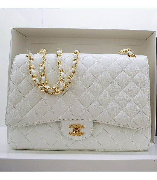 """White """"Chanel"""" Classic Flap Bag. In the 1920s, Coco Chanel became tired of having to carry her handbags in her arms and decided to design a handbag that freed up her hands. Inspired by the straps found on soldiers' bags she added thin straps and introduced the resulting design to the market in 1929. ;)"""