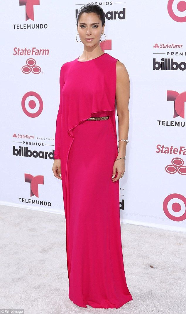 Pink lady! Roselyn Sánchez wore a draped rose pink gown that was teamed with two gold bracelets