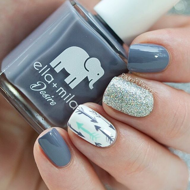 It's time for some nail art with the beautiful @ellamilapolish. This stunning grey is Mauve Over and I free handed the arrows with it, as well as added a little mint and glitter accent.