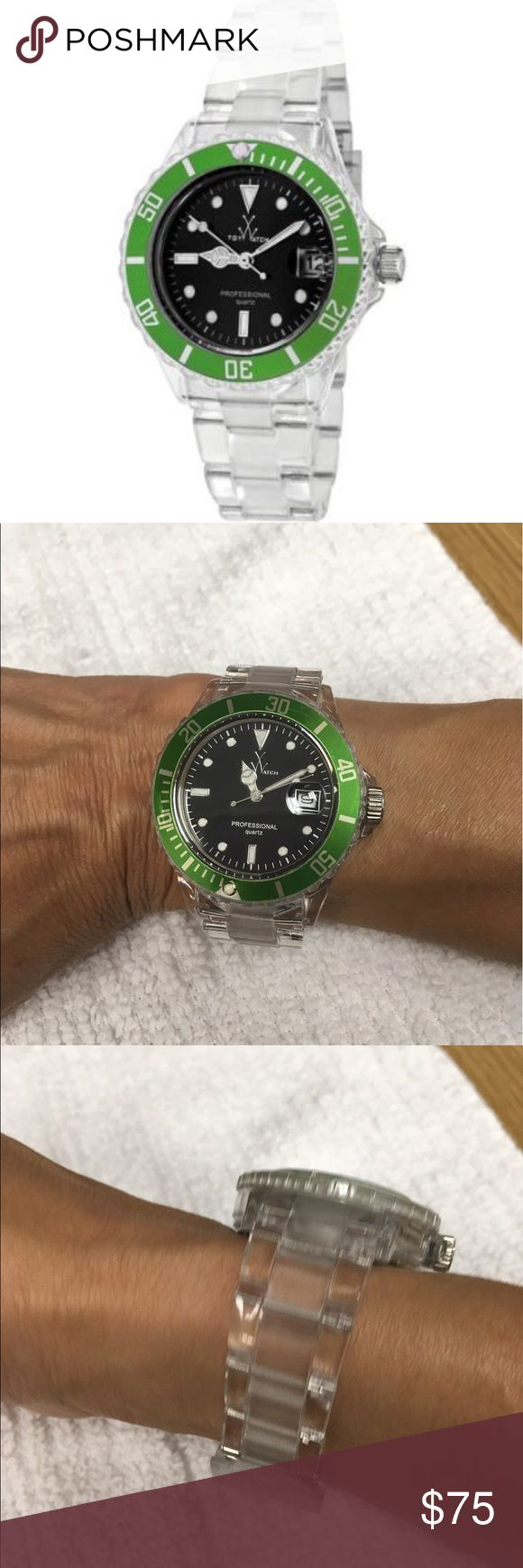 ToyWatch 1105GRP Polycarbonate construction with rotating green bezel and black dial. Finished on a clear polycarbonate bracelet. No scratches. Never worn. No box. ToyWatch Accessories Watches