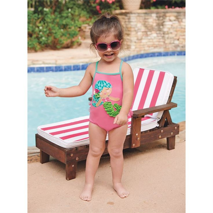 One-piece nylon spandex swim suit has dimensional mermaid applique with mesh bum ruffles. #MudPieGift