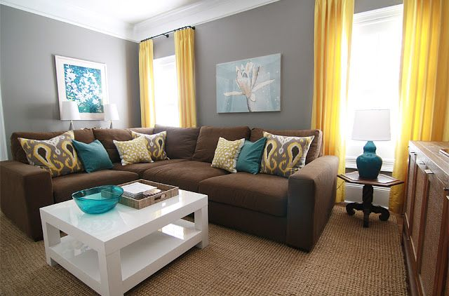I love the gray walls brown couch and teal accents for Living room yellow accents
