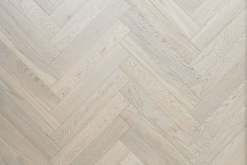 White oak engineered wood flooring in a herringbone pattern from www.element7.co.uk