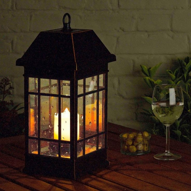 Smart Solar Seville #Lantern, As this photo suggests, this #solar lantern is perfect for a nice evening in the garden with a glass of wine :-)