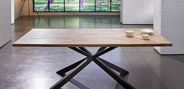 A solid oak top with finger joint pattern and brown powder coated legs. The MINCENTI dining table will create a distinguished style in any dining area where it features.