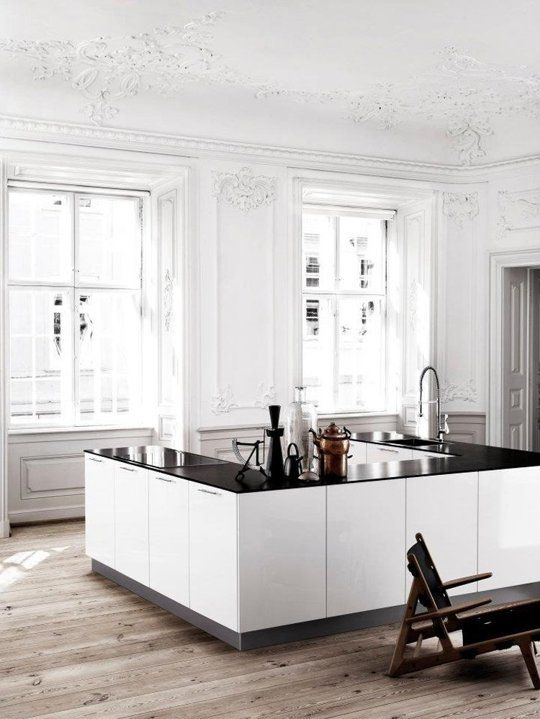It's the configuration of this kitchen that makes it eye-catching. A u-shaped kitchen with no upper cabinets takes advantage of a huge, open space. Now if only I had a gorgeous Paris apartment to build one in. Kvik via Nordic Design.