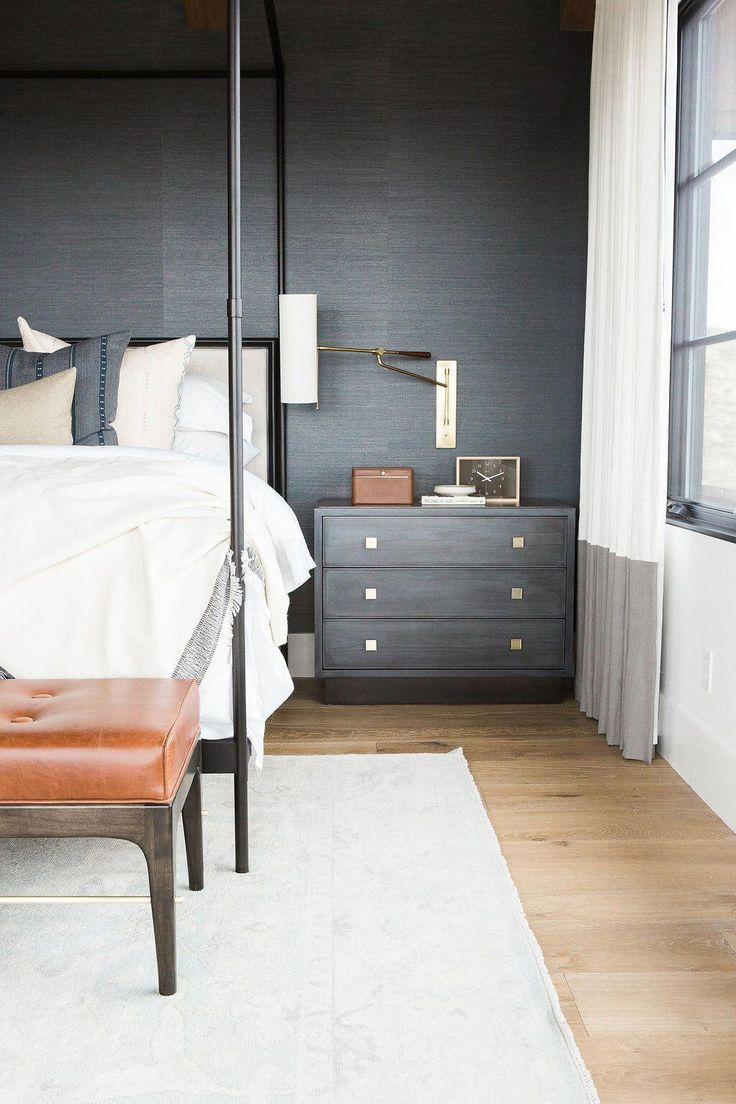 Master bedroom in blue grasscloth wallpaper, statement