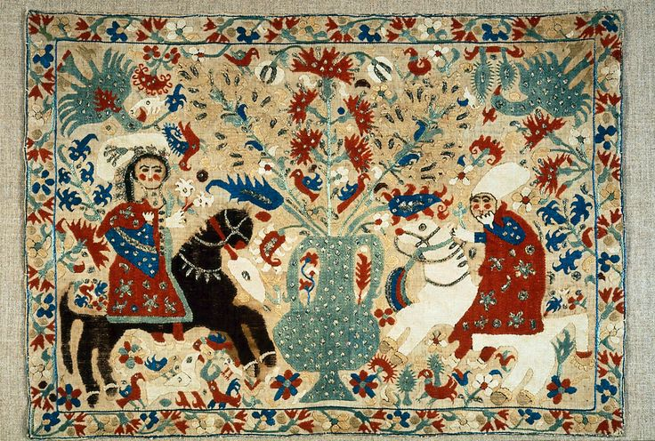 Polychrome silk and metallic yarns on undetermined ground. Design of horseman and horsewoman flanking large central vase of flowers; eagles, small birds, carnations and other flowers fill intervening spaces; border around all four sides of stemmed flowers. Black and brown yarns have largely rotted out.