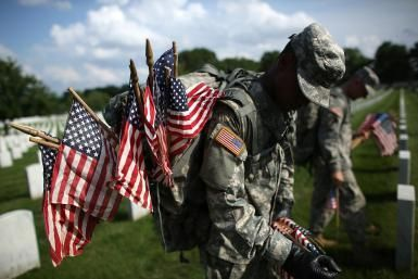 'Flags In' Ceremony Held At Arlington National Ahead Of Memorial Day - Win McNamee / Staff/Getty Images News/ Memorial Day is a day for remembering and honoring military personnel who died in the service of their country, particularly those who died in battle or as a result of wounds sustained in battle. While those who died are also remembered on Veterans Day, Veterans Day is the day set aside to thank and honor ALL those who served honorably in the military - in wartime or peacetime.