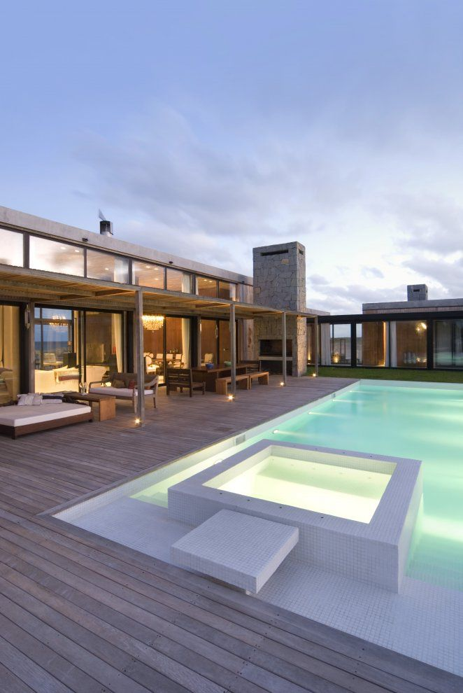 Contemporary home; pool; patio deck; outdoor fireplace.