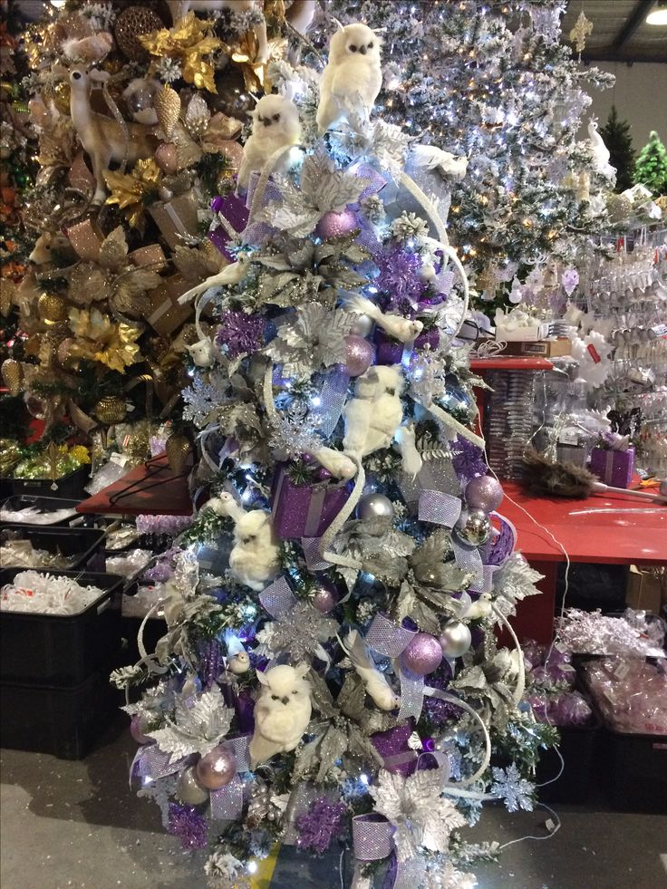 Purple, white and silver looks great on a flocked tree.