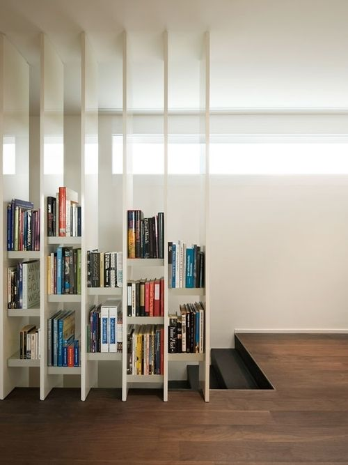 bookshelf ( modern loft / staircase / dark hardwood floors / minimalist / living room / divider / stylish storage )