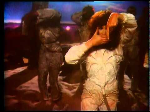 """The Dreaming"" - Kate Bush.  Man I love this song.  VERY unique song and one of the reasons I love her. :)"