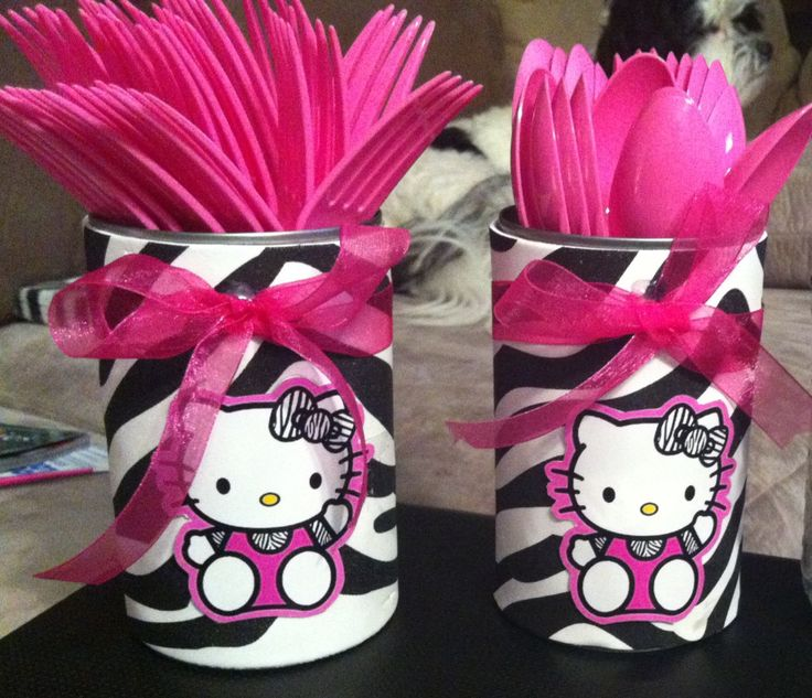 Utensil holder made for my daughters Birthday party! Recycled soup can, .79 cent foam zebra sheet from hobby lobby and 1.00 pink ribbon from hobby lobby and hello kitty party tags I found free online!
