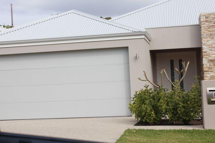 Shale Grey roof, gutters and garage door, Surfmist fascia and Dune render (100%)