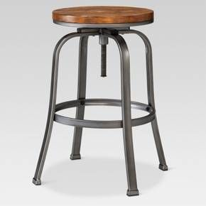• Contemporary, industrial style<br>•Distressed, espresso finish seat & black steel frame<br>• Durable construction <br>• Adjust height with a simple spin<br>• Perfect alongside counters or bars<br><br>Add a splash of classic elegance and modern style to any kitchen counter or bar area with the Dakota, Adjustable Barstool. With its easily adjustable height, this stool fits easily wherever it's n...