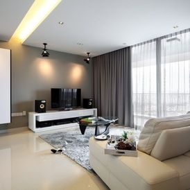 contemporary family room incorporates multi media - sheers provide filtered light and lined curtains black out for show time