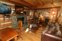 "Wildwood cabin - This lodge offers a fully equipped kitchen with indoor dining area and outdoor dining area that includes a gas grill. Has flat-screen TVs throughout the lodge with a game room that includes regulation size pool table and other amenities. As an added bonus, sit back and enjoy movies in the newly installed theater room complete with a 55"" TV and Sony Surround Sound. Enjoy the comfort of a large wood burning fireplace. Wireless internet available."