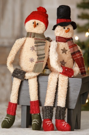 "Primitive Hanging Snowmen - Jolly Snowmen! Each snowman wears black boots, a colorful toboggan hat and scarf! They have embroidered smiles that make them look so happy, they will bring cheer to everyone who sees them on your Christmas tree! 18"" Long."
