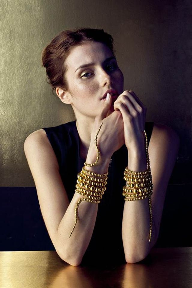 Colombian jewelry designer Paula Mendoza has made a name for herself with her signature serpent bracelet, with graduated gold beads coilingup the arm like a rattlesnake's tail. Her background in sculpture is evident in her designs, where natural and geometric elements are worked into uniquely