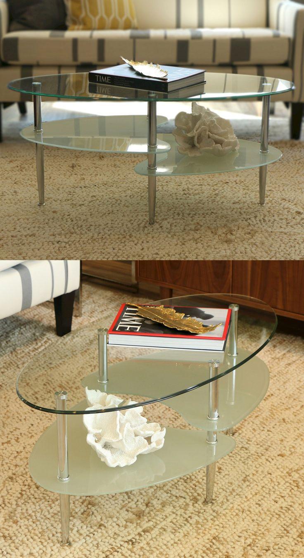 I love the way this coffee table is shaped. Saracina Home Glass Oval Living  Room Metal Coffee Table