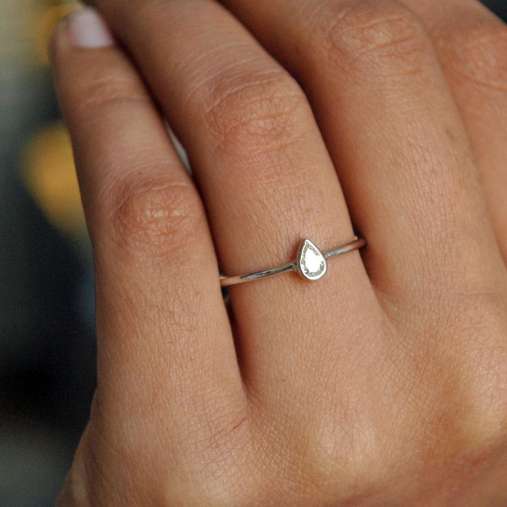Pear Diamond - Teardrop Engagement Ring - Dainty ring - White Gold Ring  A beautiful 0.21 Cts Pear Cut Diamond, handset in a pretty bezel setting in solid 18k white gold. A thin dainty ring for that perfect occasion. • Diamond Wt. : 0.21 Cts • Color-Clarity Grade : M, VS • Gold - 18kt White gold ................ Find us on Instagram for exquisite designs: @abhikajewels  Like us on Facebook: www.facebook.com/Abhikajewels  ................. Thank you for visiting our shop.. :)